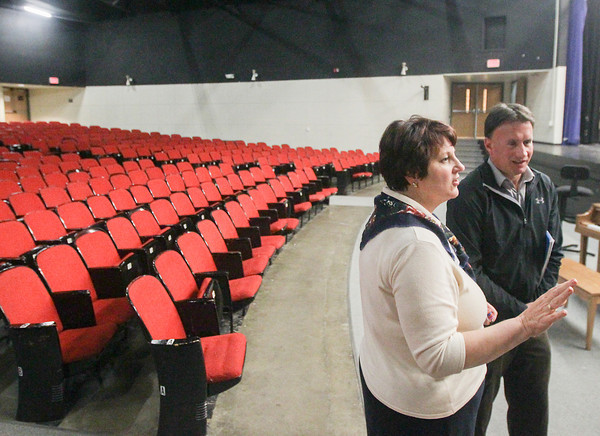 Record-Eagle/Keith King<br /> Wendy Wolf-Schlarf, left, Traverse City Area Public Schools (TCAPS) K-12 music coordinator, and Paul Mahon, TCAPS director of capital projects and maintenance, discuss Tuesday, October 15, 2013 the condition of the auditorium at Traverse City Central High School.