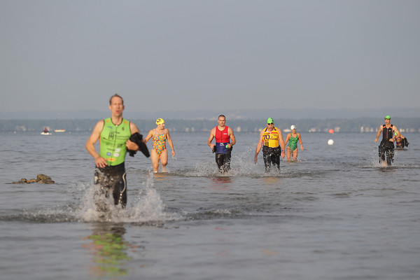 Record-Eagle/Keith King<br /> Participants exit East Grand Traverse Bay Sunday, September 01, 2013 during the Grand Traverse Resort and Spa's Barefoot Triathlon.