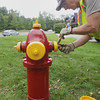 Record-Eagle/Keith King<br /> Jerry Haywood, working through Manpower with the City of Traverse City water and sewer maintenance department, applies fresh paint to a fire hydrant Wednesday, September 4, 2013 at the intersection of Fair Street and East Front Street in Traverse City.
