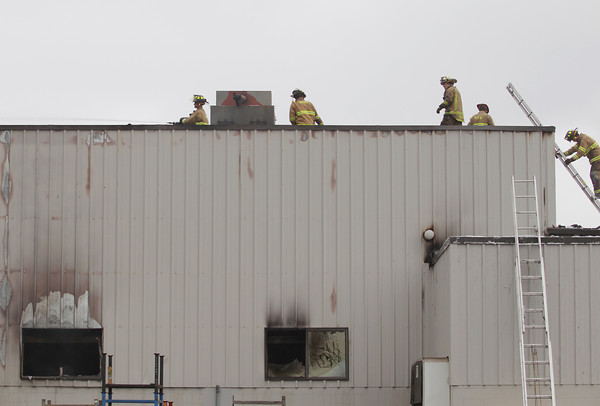 Record-Eagle/Keith King<br /> Firefighters respond to a fire Monday, September 2, 2013 at Century Sun Metal Treating on West Aero Park Court in Traverse City.