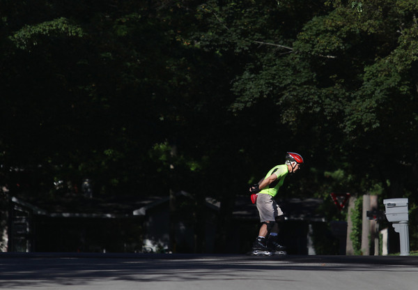 Record-Eagle/Keith King<br /> Alan Fritz, of New York, who is in town visiting family, travels with inline skates Tuesday, September 3, 2013 on Wenonah Street in Traverse City.
