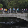 Record-Eagle/Keith King<br /> Participants travel on Front Street as they cross the Boardman River Monday, September 02, 2013 during the second annual Traverse City Labor Day Bridge(s) Walk sponsored by Traverse City Walks.