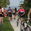 Record-Eagle/Keith King<br /> Participants utilize a staging area Sunday, September 01, 2013 to transition from the swimming to the bicycling portion of the Grand Traverse Resort and Spa's Barefoot Triathlon.