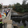 Record-Eagle/Keith King<br /> Participants take a moment along Union Street on the Trunk Line Bridge over the Boardman River Monday, September 02, 2013 during the second annual Traverse City Labor Day Bridge(s) Walk sponsored by Traverse City Walks.