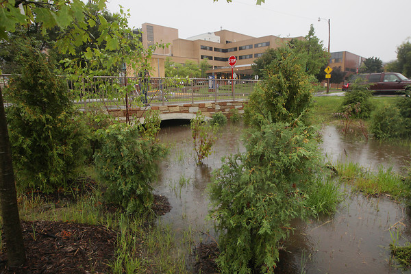 Record-Eagle/Keith King<br /> High water is visible Tuesday, August 27, 2013 at a portion of the Kids Creek restoration project near Munson Medical Center during rainfall in Traverse City.