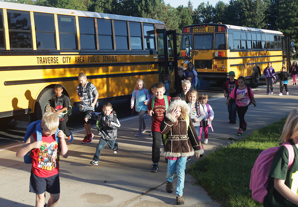 Record-Eagle/Keith King<br /> Students get off school buses Tuesday, September 3, 2013 prior to starting their first day of the school year at Blair Elementary School.