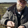 "Record-Eaglefile photo<br /> Mark Johnson, of Chateau Chantal, cuts the frozen bud of a Chardonnay grape vine. ""When I grew up in Traverse City the population swelled to 50,000 people in the summer, and 40,000 of those were migrants,"" he said."