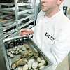Record-Eagle/Keith King<br /> James Morse, sous chef at Siren Hall, explains shellfish Wednesday, September 7, 2011.