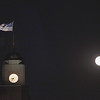 Record-Eagle/Keith King<br /> The harvest moon rises over an American flag flying atop the Fifth Third Bank Northern Michigan building at the corner of Front Street and Union Street in downtown Traverse City.