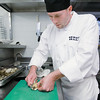 Record-Eagle/Keith King<br /> James Morse, sous chef at Siren Hall, prepares a soft shell clam Wednesday, September 7, 2011.