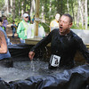 Record-Eagle/Keith King<br /> Kristine Roush and Benjamin Evans surface after submerging themselves in cold water as part of an obstacle Saturday, September 14, 2013 during the Here's Mud In Your Eye 5K at Timber Ridge RV and Recreation Resort in East Bay Township.