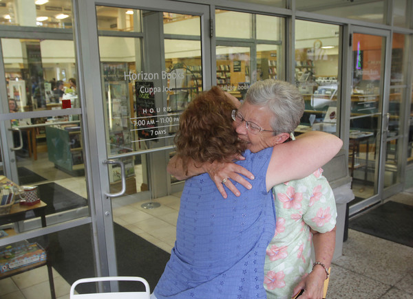 Record-Eagle/Keith King<br /> Kitty Bucholtz, left, and her former elementary school teacher in Kalkaska, Sherry Day, reunite Saturday, September 7, 2013 at Horizon Books in Traverse City. Bucholtz, an author, dedicated a book  to Day and presented her with the book.