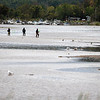 Record-Eagle/Jan-Michael Stump<br /> Fishermen cast for salmon near the mouth of the Betsie River Monday near Elberta, which officials plan to close to fishing in three weeks because of low water levels.