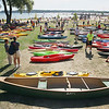 Record-Eagle/Keith King<br /> Canoes and kayaks are arranged prior to being placed into the water Saturday, September 1, 2012 for the Suttons Bay Floatilla which hopes to break the record of a raft of 1,902 canoes and kayaks as recognized by the Guiness Book of World Records. Proceeds from the event go to the Suttons Bay Schools Student Activities Fund.