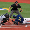 Record-Eagle/Jan-Michael Stump<br /> Traverse City Beach Bums third baseman Jose Vargas (13) beats the tag by Southern Illinois Miners catcher Chris Anderson on Jeff Flagg's first-inning double Thursday at Wuerfel Park.