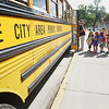 Record-Eagle/Keith King<br /> Students wait to board a bus after being dismissed Tuesday, September 4, 2012 after the first day of school at Central Grade School.