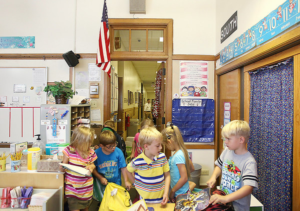 Record-Eagle/Keith King<br /> First-grade students in Stephanie Jackson's class prepare to be dismissed Tuesday, September 4, 2012 after the first day of school at Central Grade School in Traverse City.