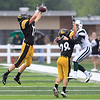 Record-Eagle/Jan-Michael Stump<br /> Traverse City Central defensive backs AJ Mackie (17) and Landon Adams (28) break up a pass for Alpena wide receiver Kaleb Smith (21) Friday at Thirlby Field.