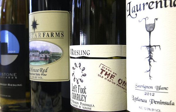 Record-Eagle photo/Nathan Payne<br /> Wine shops like the Blue Goat stock a plethora of wine from small local wineries.