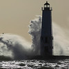 Record-Eagle/Jan-Michael Stump<br /> Monday's heavy winds, with gusts as much as 40 miles per hour, whip waves across the Frankfort Lighthouse.
