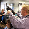 Record-Eagle/Carol Thompson <br /> Joseph Smith styles Chloe Holstein's hair at Studio Josef's. Holstein is graduating from Phoenix Hall, Addiction Treatment Services' women's residential facility, on Tuesday.