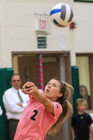 Record-Eagle/Pete Rodman<br /> Traverse City West's Mikenna Ray returns a serve from Traverse City Central during the game at Traverse City West High School on Wednesday. TC West defeated TC Central 3-0.