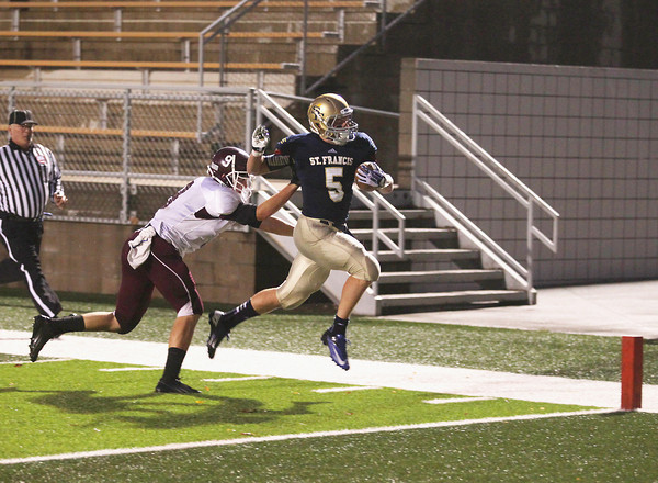 Record-Eagle/Keith King<br /> Traverse City St. Francis' Byron Bullough (5) scores a touchdown against Charlevoix Friday, October 4, 2013 at Thirlby Field in Traverse City.
