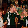 Record-Eagle photos/James Cook<br /> Traverse City West's Katie Placek smiles after recording her 1,000th career kill Wednesday against Traverse City Central, joined by teammates Alyson Peters (5) and Kimmy Bilinski (4). The Titans won 25-21, 25-10, 25-13.