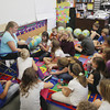 Record-Eagle/Keith King<br /> Michelle Charland reads to fourth-grade students Wednesday, October 2, 2013 in her class at Central Grade School in Traverse City.