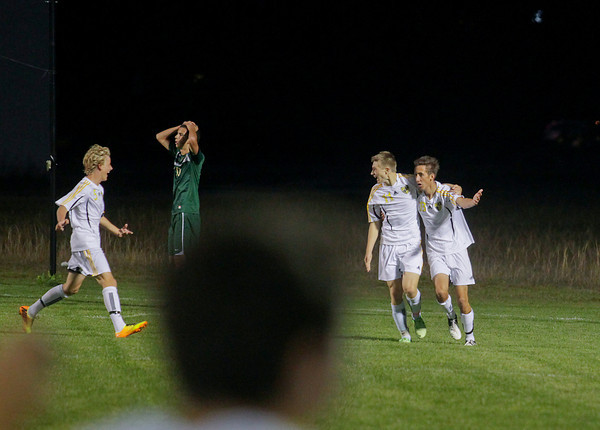 Record-Eagle/Keith King<br /> Traverse City Central's Sam Huver (5), from left, runs to celebrate with teammates Owen Stratton (11) and Connor Hansen (13), right, after Hansen scored a first-half goal against Traverse City West Tuesday, October 8, 2013 in Traverse City.