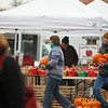 Record-Eagle/Jan-Michael Stump<br /> Virginia Roberts of Traverse City gets help carrying pumpkins to her car from Michael Popp-Trevino of Popp Farms in Omena on Saturday at the last Sara Hardy Farmers Market of the year in Traverse City.