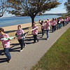Record-Eagle/Keith King<br /> Participants walk with bras between West Grand Traverse Bay and Grandview Parkway Saturday, September 29, 2012 during the second annual Bras Along the Bay. The event is focused on raising breast cancer awareness and to raise money for the Munson Medical Center Mammography Assistance Fund.