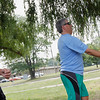 Record-Eagle/Jan-Michael Stump<br /> Kevin Graber takes a turn during a game of bocce ball with his wife, Heidi, and son Chris, at Traverse City State Park.