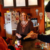 "Record-Eagle/Jan-Michael Stump<br /> ""It's still tourist season, you don't take a day off. You do that in March when no one is around,"" said Sarah Dalgliesh, here serving Kaye and Rick Mitchell, of St. John's, Monday at her coffee shop, Crow About It Coffee and Cakes, in East Bay Township. Dalgliesh said the business had been busy all day, from both tourists and locals."