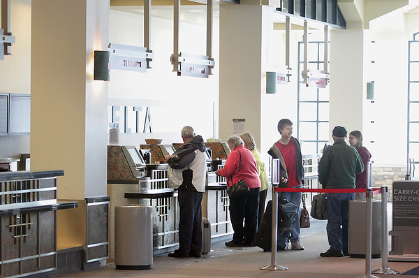 Record-Eagle file photo/Keith King<br /> Travelers line up behind a Delta Airlines ticket counter at the Cherry Capital Airport in Traverse City.