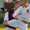 Record-Eagle/Jan-Michael Stump<br /> Suttons Bay's Ian Callewaert (4) kicks the ball away from Traverse City Christian's Jared Argyle (7) in the first half of Thursday's game. Christian won 4-1.