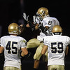 Record-Eagle/Jan-Michael Stump<br /> Traverse City St. Francis' Zach Swaffer (45), Devin Sheehy-Guiseppi (21) and Collin Schmuckal (59) celebrate Riley Bullough's touchdown run during Friday's win at Elk Rapids.