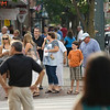 Record-Eagle/Keith King<br /> Pedestrians wait t cross at the intersection of Cass and Front streets in bustling downtown Traverse City.
