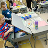 Record-Eagle/Keith King<br /> Jaden Emerson, left, places school supplies in his desk as he visits with classmate, Drew Deal, in Sally Thompson's first-grade class Tuesday, September 6, 2011 during the first day of the school year at Long Lake Elementary School.