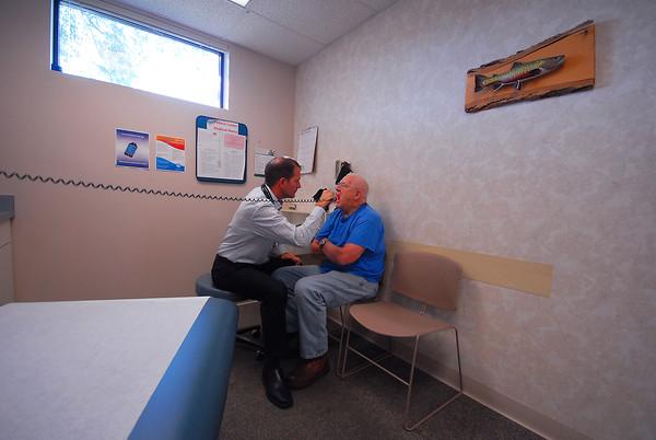 Record-Eagle/Dan Nielsen<br /> Dr. Jeremy Holmes examines Sam Lewis, of Kalkaska, Monday at Kalkaska Medical Associates.