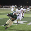 Record-Eagle/Keith King<br /> Traverse City West's Grant Balino (22) runs the ball against Traverse City Central Friday, September 13, 2013 during the Traverse City Patriot Game at Thirlby Field.