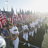 Record-Eagle/Keith King<br /> Traverse City Central High School varsity football players shake hands with veterans, and family members of veterans, prior to Traverse City West players doing the same Friday, September 13, 2013 before the start of the Traverse City Patriot Game at Thirlby Field.