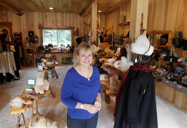 Record-Eagle/Keith King<br /> Chris Nelson, who, along with her family, owns Crystal Lake Alpaca Farm and Crystal Lake Alpaca Boutique, stands Wednesday, September 4, 2013 in the Crystal Lake Alpaca Boutique in Crystal Lake Township.