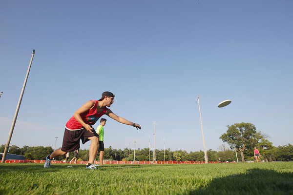 Record-Eagle/Keith King<br /> Nicco Pandolfi, of Traverse City, throws a disc as Chris Courtright, back, president of Traverse City Ultimate, stands near Tuesday, September 10, 2013 during an ultimate flying disc clinic which is to be followed by open play at the Grand Traverse County Civic Center presented by Traverse City Ultimate. The clinic and open play are scheduled to take place on Tuesdays beginning with the clinic at 6:00 p.m. followed by open play at 7:00 p.m. at the Grand Traverse County Civic Center. Ultimate flying disc open play games are also scheduled for Saturdays at noon at the Grand Traverse County Civic Center. For more information visit the 'Traverse City Ultimate' Facebook page.