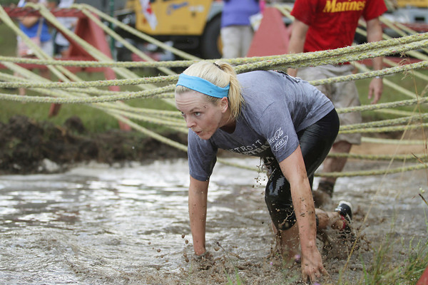 Record-Eagle/Keith King<br /> Becky Tomezak completes the final obstacle before reaching the finish line Saturday, September 7, 2013 during the King of the Mountain 5k at the Mt. Holiday Ski and Recreation Area in Traverse City.