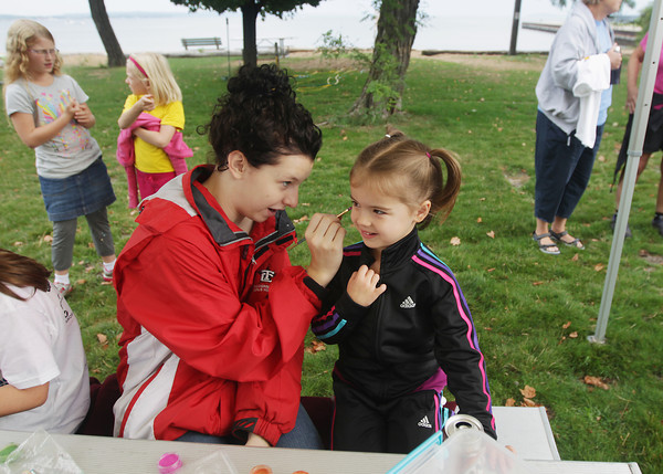 Record-Eagle/Keith King<br /> Anna Muzzarelli, left, of Traverse City, paints a unicorn on Elleana Johnson, 4, of Traverse City Saturday, September 7, 2013 at Sunset Park prior to the start of the JDRF Walk to Cure Diabetes.