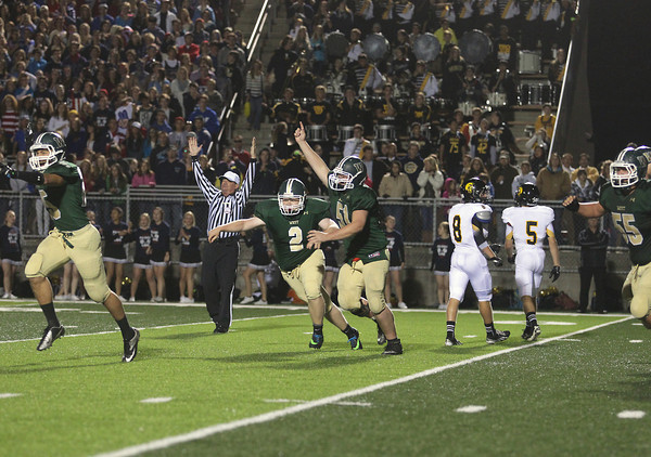 Record-Eagle/Keith King<br /> Traverse City West's Zach Gloshen (2) celebrates with teammates after kicking the game-winning field goal in overtime to defeat Traverse City Central Friday, September 13, 2013 during the Traverse City Patriot Game at Thirlby Field.