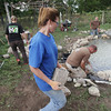 "Record-Eagle/Keith King<br /> Heather Butler, with Consumers Energy,Jason Hobson, owner of Lightning Turtle Landscapes and Cal Brinks, with Lightning Turtle Landscapes, volunteer as they do work on building a pond at Reining Liberty Ranch Thursday, September 12, 2013 during the United Way of Northwest Michigan Day of Caring. ""They didn't meet expectations in everything they did, they exceeded expectations in everything they did,"" Becki Bigelow, executive director of Reining Liberty Ranch, said."