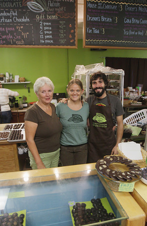 Record-Eagle/Keith King<br /> Mimi Wheeler, from left, Jody Dotson and DC Hayden stand Saturday, September 7, 2013 at Grocer's Daughter Chocolate in Empire.