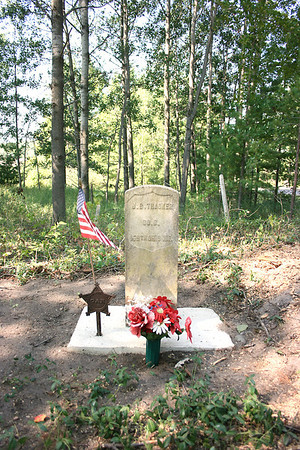 Record-Eagle/Loraine Anderson<br /> Civil War veteran J.B. Thacker's grave, restored by Elmwood Township resident John Sawyer, who has spent the summer cleaning up the long overgrown Fouch Road Cemetery.